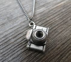 "Men's Necklace - Men's Camera Necklace - Men's Silver Necklace - Mens Jewelry - Necklaces For Men - Jewelry For Men - Gift for Him  Looking for a gift for your man? You've found the perfect item for this!   The simple and beautiful necklace features blackend silver plated chain with camera pendant.  Available in two lengths: 19.6"" (50 cm ), 25"" (65cm). $35"
