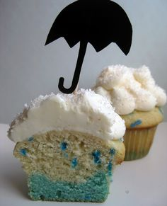 Rainy day cupcake! Divide vanilla cake batter. Add blue food coloring to one half, and blue sprinkles to the other. Fill cupcake tins with the blue batter first to create the 'puddle', then fill with the sprinkle batter to create the rain drops. White whipped icing as clouds, and top it all off with an umbrella topper.