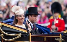 The Duchess of Cambridge and Prince William enter the Mall through Admiralty Arch in their horse-drawn carriage