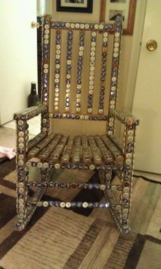Chair covered with beer caps... Built for a note of amusement... Not for comfort!