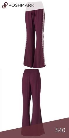Embroidered wide leg pants Bring boho style to your casual wardrobe with these pants.  PRODUCT FEATURES Smocked elastic waistband with drawstring accent Embroidered sides Unlined FIT & SIZING 33-in. approximate inseam High rise sits on the natural waistline Wide leg opening FABRIC & CARE Rayon Machine wash A* Pants