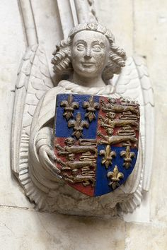 Angel bearing the Royal coat of arms in King's College Chapel, Cambridge. These are the arms of King Henry IV and were used intermittently until 1603.