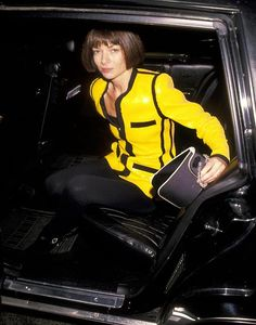 Anna Wintour during the early '90's, wearing Chanel's sequinned 'bicycle rider' jacket and leggings.