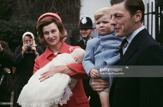 Princess Alexandra of Kent, The Honourable Lady Ogilvy pictured holding her newborn daughter Marina Victoria Alexandra Ogilvy alongside her husband Angus Ogilvy (1928-2004) holding their son James Ogilvy in London in 1966.