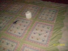 FLOWER BASKET QUILT~ scalloped boarder edge, hand tied , made from quilt blocks and stripping sashing . by Shelia Taylor