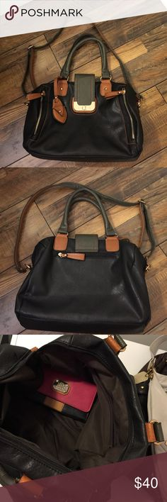 Mod Handbag Beautiful very gently used bag.  Wallet is included as a gift.  Interior Two Backwall zip pockets, two slip pockets and three exterior zip pockets.  Zipper and twist lock closure. This bag will not disappoint. Manmade material MOD Bags Satchels