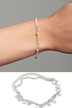 This stunningly delicate bracelet has two sterling silver chains one with a row of white freshwater pearls. This intertwined layered bracelet adds a gentle pop of colour to any outfit.