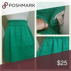 J. CREW GREEN 100%LINEN SKIRT J. CREW GREEN 1OO%LINEN SKIRT PRE-OWNED  SIZE 10 FULLY LINED  SPRING 2013 COLLECTION  19' LONG  15' WAIST  ELASTIC STRETCHY  COMFORTABLE WAISTBAND J. Crew Skirts