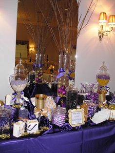 Cute candy buffet, I like the idea of branches in cylinder vase with wedding color bulbs in the bottom.