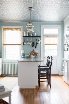 The kitchen. The family kept the vintage tin ceiling, and re-painted it silver to match its original color.
