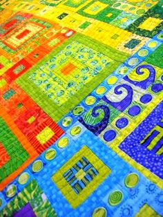 This quilt is so gorgeous! Seriously! The colors are so vivid and bright, but the blocks and the tiny hand-cut pieces? Amazing work!