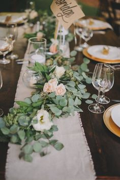 An example of one of the alternating table ideas! Just a simple table runner with some small plants around it