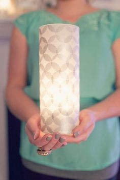 Take a tall thrift store vase, some punched out tissue paper and homemade mod podge and make these beautiful  hurricanes. DIY Tissue Covered Luminaries :: Hey Gorgeous, The Blog by susana