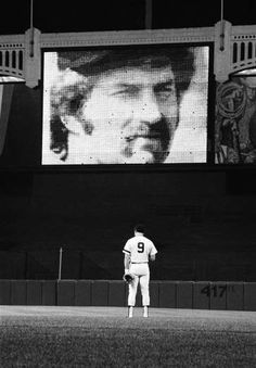 New York Yankees third baseman Graig Nettles bows his head on the field at New York's Yankees Stadium, Aug. 3, 1979 during ceremonies honoring the memory of Yanks catcher Thurman Munson killed in an airplane crash Aug. 2, 1979. Munson's picture is displayed on the centerfield scoreboard prior to the Yanks-Baltimore Orioles game.