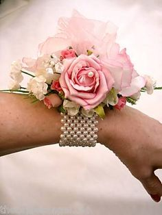 Pearl wrist corsage bracelet.  Bring out your inner Princess, floral jewelry is super hot this Prom Season!  We can replicate your favorite designs and match your corsage to your dress.  Find us at www.flowersofcharlotte.com