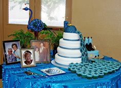 Cake table, with pictures of our deceased grandparents. They were there in spirit! #peacockwedding #caketable #wedding
