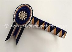 Navy Velvet, midnight velvet, honey gold satin and white satin sharkstooth shown detailed with oval rosettes and standard swallowtail flags  www.silverburnbrowbands.co.uk
