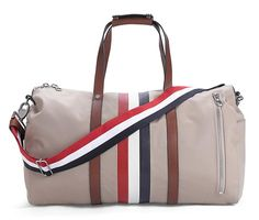 I love Thom Browne. His signature red, white & blue stripes for Brooks Brothers Black Fleece Mackintosh Duffel. $695