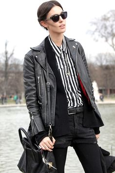 striped shirt and leather jacket.