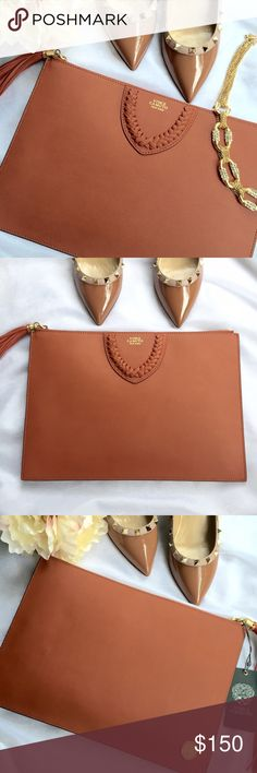 Vince Camuto envelope clutch Beautiful leather Vince Camuto clutch is a perfect staple price to add to your fall collection! Measures 13x9 inches. Has 8 card slot pockets and another bigger slip pocket. Bag has gold too zipper with tassel. Will come with dust bag. Vince Camuto Bags Clutches & Wristlets
