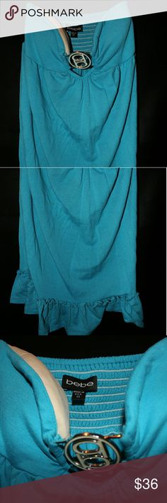 BEBE blue swim cover up. Blue Terry cloth material. Silver bebe center clasp. Stretchy tube top. Lightly worn, shows no sign of wear or age. The breast area is also slightly padded. bebe Swim Coverups