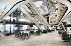 Completed in 2014 in Baku, Azerbaijan. Images by Kerem Sanliman. The new terminal at Azerbaijan's Heydar Aliyev International Airport will soon open in the country's capital of Baku. The landmark terminal features. Oslo Airport, Airport Lounge, Turkish Architecture, Interior Architecture, Interior Design, Azerbaijan Airlines, Baku Azerbaijan, Airport Design, Arquitetura