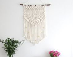 This piece is made using ecru cotton cord, a wooden stick and gold brass tubes. It features a Josephine knot in the centre of the piece. There is a romantic feel to it, and would suit a neutral or monochrome decor. Approximate measurements: Wooden stick - 54 cm Height from wood - 72 cm Height including hanging rope - 92 cm More wall hangings available here: https://www.etsy.com/shop/tentvintage?section_id=17198962&ref=shopsection_leftnav_3 * Please not...