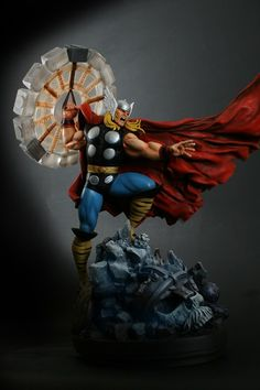 "Thor Classic Action statue Sculpted by: Randy Bowen Release Date: November 2011 Edition Size: 2750 Order Of Release: Phase IV (statue #258) Over 19"" tall Features an interchangable right hand Spinning hammer digitally sculpted by Avinash Hegde"