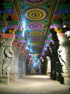 Colorful architecture at Meenakshi Amman Temple in Madurai, India (by robotsergio).