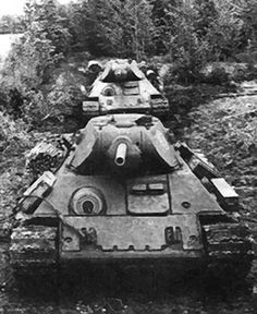 """T-34 Model 1942 s ekranami (Russian for """"with screens""""), with appliqué armour welded to the hull, near Leningrad, 1942"""