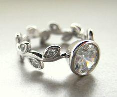 14k white gold engagement leaf ring. 1ct white sapphire center stone.