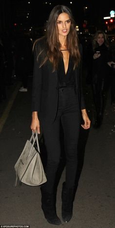 Striking: Bralzilian beauty Izabel Goulart opted for an all-black look as she headed home...