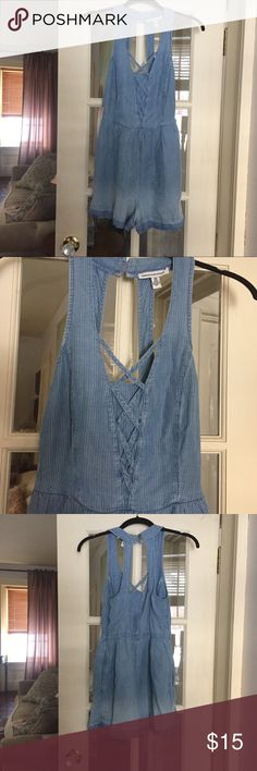 American Eagle denim romper size xxs NWOT! Took the tags off and then never wore it. Super cute but not really my style. Impulse buy 🙈🙈🙈. American Eagle outfitters brand size XXS. Cute criss cross detail in front. Zips up the side and buttons on the top back. I love the white pin-striping in the soft denim! American Eagle Outfitters Other