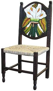 This exquisitely hand-carved and hand-painted Calla Lily chair was created with pride by the renowned Perla furniture studio of Michoacan, Mexico. Imagine sitting down to a scrumptious south-of-the-border meal with your family and friends in these eye-catching chairs! A striking and colorful addition to your home décor, they're the perfect way to embrace your own Mexican or Southwestern spirit, and to bring out the interior decorator in all of us!