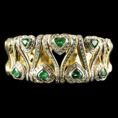 Wide Emerald and Diamond Bracelet. Accompanied by 5.00 carats of Emeralds and 4.00 carats of Diamonds. Mounted in 18 karat Yellow Gold.