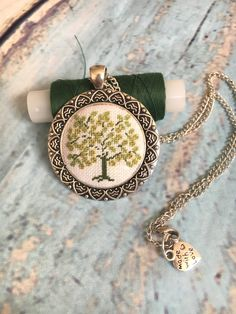 This beautiful hand embroidered necklace Green Tree is perfect as a wonderful gi. This beautiful hand embroidered necklace Green Tree is perfect as a wonderful gift for someone special: you, your mo Tiny Cross Stitch, Cross Stitch Designs, Cross Stitch Embroidery, Cross Stitch Patterns, Hand Embroidery, Cross Stitching, Diy Jewelry Necklace, Green Necklace, Jewelery