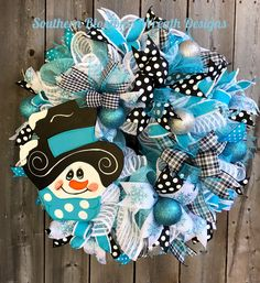 A personal favorite from my Etsy shop https://www.etsy.com/listing/554166944/snowman-wreath-winter-wreath-christmas
