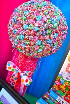 THIS would be stunning....get a foam ball and stick a bunch of lollipops in. Prefect for a summer birthday party.
