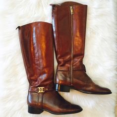 """Authentic TORY BURCH brown leather riding boots Beautiful leather and craftsmanship. It's been girls dream boots for several years now. Still the biggest holiday wish list item!! It's Tory's signature most popular brow color with gorgeous gold logos. It is pre loved and has some wears (over 1"""" scar on top of left toes...see pic). Other than that, still in good condition. Tory Burch Shoes Winter & Rain Boots"""