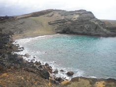One of the most beautiful places on earth (that I have been to). Green sand beach at the southern tip of the Big Island in Hawaii.