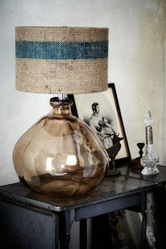 Smokey glass with burlap shade.