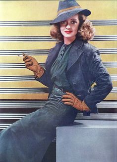 Bette Davis in a spring ensemble 1938  Bette is wearing a tri-color spring ensemble of suede. Design by Voris