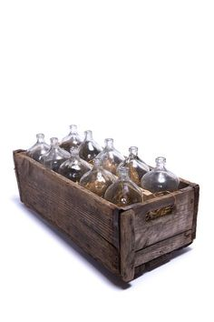 French Bottles in Wood Carrier.