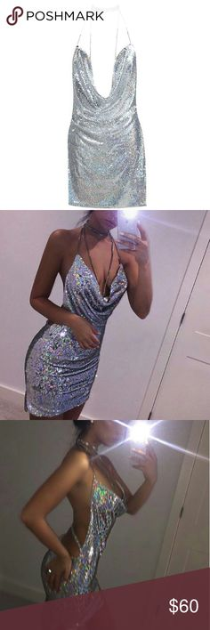Sequin Mini Dress Sexy, revealing sequin mini dress. Tye around halter with silver chains. Great dress for parties. Sparkly and shiny. Dresses Mini