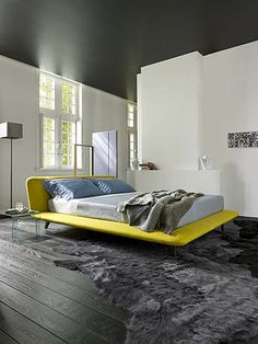 Uzume by Ligne Roset - named after the Japanese goddess of joy and good humor. Low bed, yet available in 3 heights, and all in curves faithful to Eric Jourdan's trademark, it is placed on the floor and looks like a large cushion, an invitation to rest Fine Furniture, Contemporary Furniture, Furniture Decor, Bedroom Furniture, Furniture Design, Ligne Roset, New Beds, Upholstered Beds, Double Beds