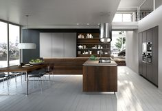 Way, Snaidero Design. Doors in smoked oak wood and matte metallized lead grey lacquer.