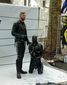 maxatl: ozzkink: knotsofvengeance: There's something about these photos of standing Masters and rubbered-up and kneeling slaves that's so hot. Maybe it's the feeling that the slave is giving up its right to be seen in posterity in the photo. Maybe the fact that one can identify only the Master, and that the slave can be seen but not recognized…the idea of a slave fading into the background, and then into oblivion…yeah, that's hot. Leather'd One day….. Sigh!
