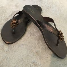 Brown sandals. Size 9 Super cute brown flip flops with bronze beaded accent. Size 9. Flojos Shoes Sandals