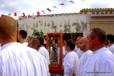 Into the Village of San Salvatore: the Saint.