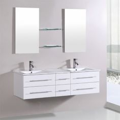 This free standing modern designed vanity for two is the perfect addition to enhance your dream bathroom. Equipped with four soft-close drawers and matching sleek silver faucets, this vanity has plenty of storage room while offering a sleek organized look. This top quality vanity also comes with two stand alone mirrors along with two shelves, built with exceptional quality, functionality, and beauty! Luxury Bathroom Vanities, Storage Room, Faucets, Contemporary, Modern, Double Vanity, Mirrors, Drawers, Shelves